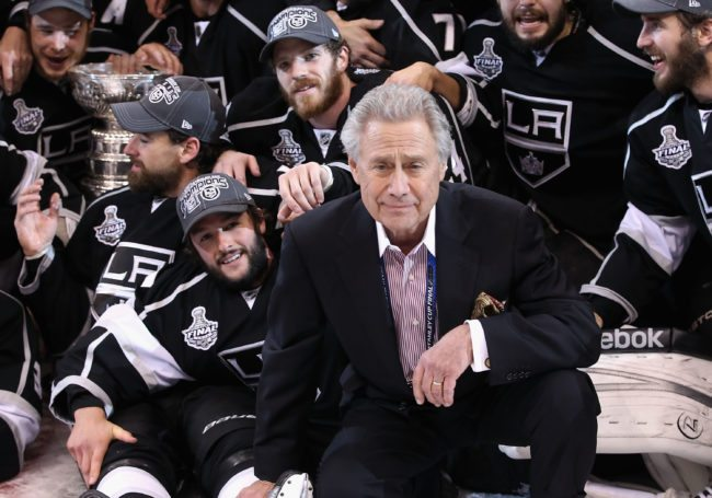 LOS ANGELES, CA - JUNE 11:  Owner of the Los Angeles Kings, Philip F. Anschutz poses with the team and the Stanley Cup after defeating the New Jersey Devils in Game Six of the 2012 Stanley Cup Finals at Staples Center on June 11, 2012 in Los Angeles, California. The Kings defeated the Devils 6-1 to win the series 4 games to 2.  (Photo by Christian Petersen/Getty Images)