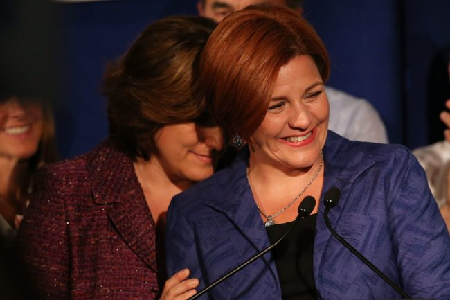 NEW YORK, NY - SEPTEMBER 10: New York City Council Speaker Christine Quinn speaks next to her wife Kim Catullo (L) during her concession speech in the New York Democratic mayoral primary elections on September 10, 2013 in New York City. Quinn, who lead early in the polls and who was endorsed by all of New York's major newspapers, saw her lead slip away in the final weeks of the campaign. Quinn would have been the first woman and lesbian to hold the job of mayor. (Photo by Spencer Platt/Getty Images)
