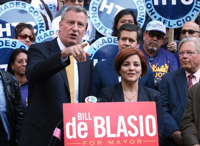 NEW YORK, NY - SEPTEMBER 17: Democratic mayoral nominee Bill de Blasio (L) speaks as Christine Quinn (R), New York City Council Speaker and former mayoral hopeful, stands by at a news conference where Quinn endorsed de Blasio outside City Hall on September 17, 2013 in New York City. De Blasio will face Republican Joseph Lhota in the general mayoral election November 5, 2013, with the winner succeeding current Mayor Michael Bloomberg. (Photo by Mario Tama/Getty Images)