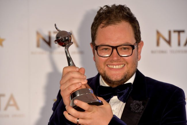 LONDON, ENGLAND - JANUARY 21:  Alan Carr poses in the winners room with his award for Best Chat Show Host at the National Television Awards at 02 Arena on January 21, 2015 in London, England.  (Photo by Anthony Harvey/Getty Images)