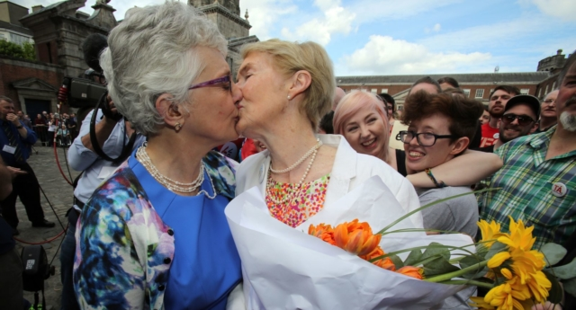 Irish Senator Katherine Zappone (L) kisses her partner Ann Louise Gilligan as supporters for same-sex marriage wait for the result of the referendum at Dublin Castle on May 23, 2015 in Dublin. (Photo by PAUL FAITH/AFP/Getty Images)