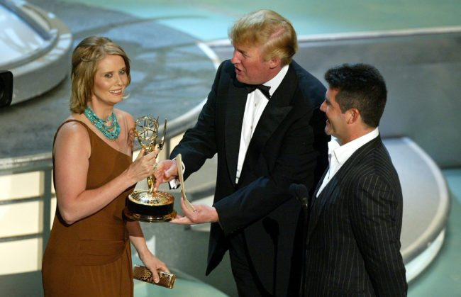 "LOS ANGELES - SEPTEMBER 19: Actress Cynthia Nixon accepts her award for Best Supporting Actress in a Comedy Series for ""Sex and the City"" with Donald Trump (L) and TV Personality Simon Cowell on stage during the 56th Annual Primetime Emmy Awards at the Shrine Auditorium September 19, 2004 Los Angeles, California. (Photo by Vince Bucci/Getty Images)"