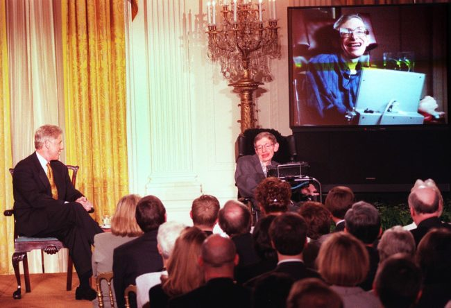 "WASHINGTON, : US President Bill Clinton (L) and Professor Stephen Hawking -- in person and on screen -- watch a scene from ""Star Trek the Next Generation"", during a ""Millennium Evening"" at the White House 06 March in Washington DC. Theoretical physicist Hawking talked about the future of science during the live telecast with the Clintons. AFP PHOTO Tim SLOAN (Photo credit should read TIM SLOAN/AFP/Getty Images)"