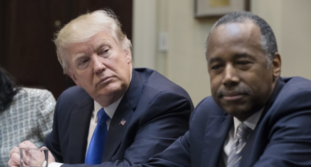 US President Donald Trump arrives with Secretary of Housing and Urban Development Ben Carson (Photo by Michael Reynolds - Pool/Getty Images)