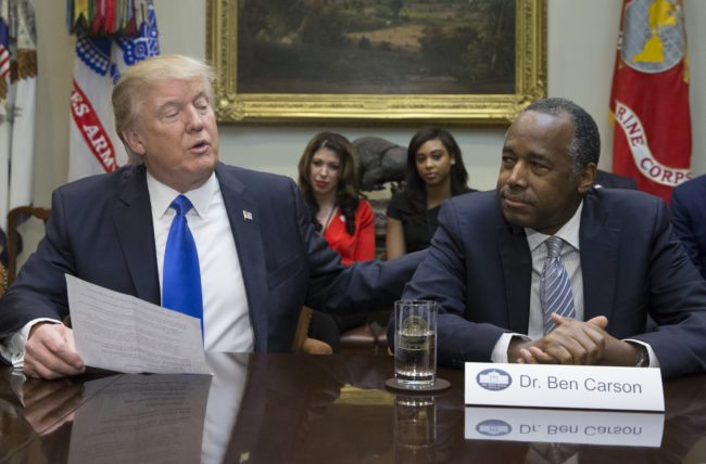 WASHINGTON, DC - FEBRUARY 1:  (AFP OUT) President Donald Trump (L), holds an African American History Month listening session attended by nominee to lead the Department of Housing and Urban Development (HUD) Ben Carson (R) and other officials in the Roosevelt Room of the White House on February 1, 2017 in Washington, DC. (Photo by Michael Reynolds - Pool/Getty Images)