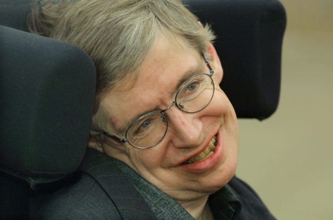 399485 04: Physicist Stephen Hawking smiles at a symposium to honor his birthday at the Center for Mathematical Sciences at the University of Cambridge January 11, 2002 in Cambridge, England. Hawking turned 60-years-old on January 8, 2002 and is the Lucasian Professor of Mathematics, a post once held by Sir Isaac Newton. (Photo by Sion Touhig/Getty Images)
