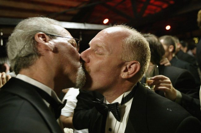 WEST HOLLYWOOD, CA - JUNE 1: Men kiss after exchanging marriage vows during a symbolic mass gay wedding celebrated by more than 100 same-sex couples on June 1, 2004 in West Hollywood, California. The ceremony kicks off National Gay Pride Month. (Photo by David McNew/Getty Images)
