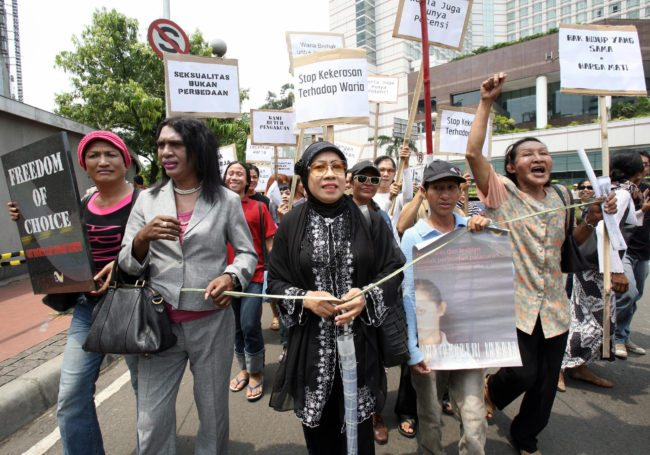 Indonesian transvestites of Solidaritas Transgender march during a protest in Jakarta, 20 November 2007. Scores of Indonesian transvestites held a protest against discrimination on transvestites, transexual, gay and lesbian in Indonesia, the most populous Muslim country in the world. AFP PHOTO/ADEK BERRY (Photo credit should read ADEK BERRY/AFP/Getty Images)