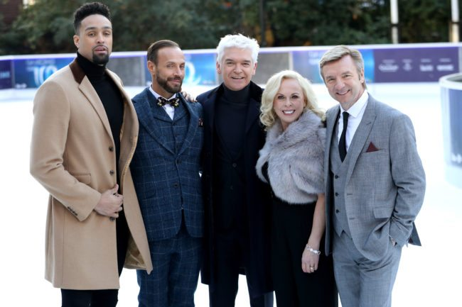LONDON, ENGLAND - DECEMBER 19:  Presenter Phillip Schofield (C) poses with judges Ashley Banjo (L), Jason Gardiner (2ndL), Karen Barber (2ndR) and Christopher Dean (R) during the Dancing On Ice 2018 photocall held at Natural History Museum Ice Rink on December 19, 2017 in London, England.  (Photo by Chris Jackson/Getty Images)