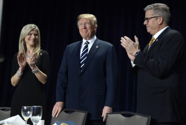 WASHINGTON, D.C. - FEBRUARY 8: (AFP-OUT) Rep. Randy Hultgren (R-IL) (R) and his wife Christy clap for President Donald Trump at the National Prayer Breakfast on February 8, 2018 in Washington, DC. Thousands from around the world attend the annual ecumenical gathering and every president since President Dwight Eisenhower has addressed the event. (Photo by Mike Theiler-Pool/Getty Images)