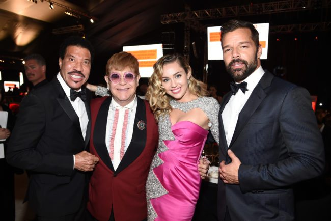 WEST HOLLYWOOD, CA - MARCH 04: (L-R) Lionel Richie, Sir Elton John, Miley Cyrus, and Ricky Martin attend the 26th annual Elton John AIDS Foundation Academy Awards Viewing Party sponsored by Bulgari, celebrating EJAF and the 90th Academy Awards at The City of West Hollywood Park on March 4, 2018 in West Hollywood, California. (Photo by Dimitrios Kambouris/Getty Images for EJAF)