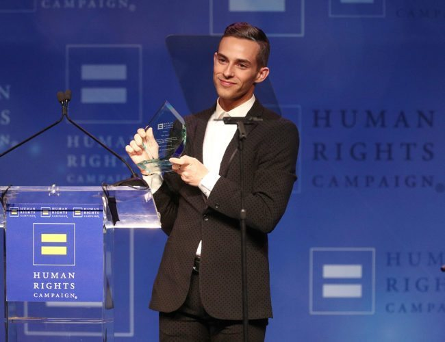 LOS ANGELES, CA - MARCH 10: Adam Rippon celebrates as he is honored with the Visibilty Award during the Human Rights Campaign 2018 Los Angeles Dinner at JW Marriott Los Angeles at L.A. LIVE on March 10, 2018 in Los Angeles, California. (Photo by Frederick M. Brown/Getty Images)