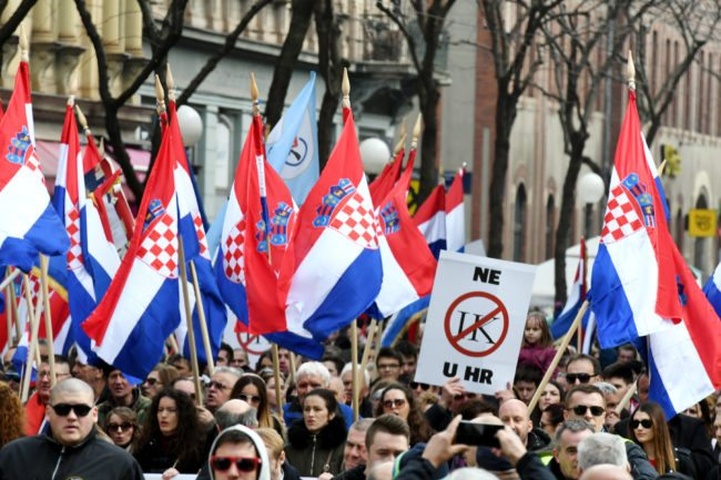 "Opponents to a treaty safeguarding women, backed by the Roman Catholic Church, protest against its ratification arguing it is imposing what they call a ""gender ideology"" in the Croatian capital, Zagreb, on March 24, 2018. Protestors against the Council of Europe convention on preventing and combating violence against women and domestic violence (Istanbul Convention) -- the world's first binding instrument to prevent and combat violence, from marital rape to female genital mutilation -- hold banners against its ratification, an issue that has split the Balkan country.  / AFP PHOTO / STR        (Photo credit should read STR/AFP/Getty Images)"