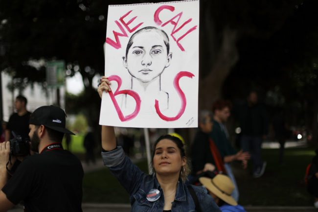 LOS ANGELES, CA - MARCH 24:  A woman holds a sign depicting Parkland shooting survivor Emma Gonzalez during the March for Our Lives rally on March 24, 2018 in Los Angeles, United States. More than 800 March for Our Lives events, organized by survivors of the Parkland, Florida school shooting on February 14 that left 17 dead, are taking place around the world to call for legislative action to address school safety and gun violence.  (Photo by Mario Tama/Getty Images)