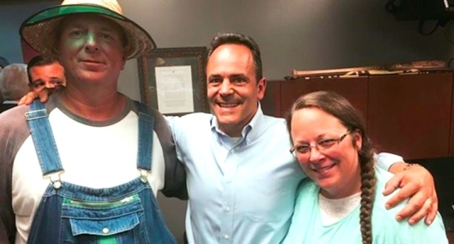 Kim Davis (far right) poses with her latest husband and Matt Bevin, the Governor of Kentucky