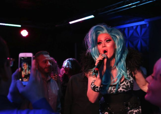 blue hair drag queen singing