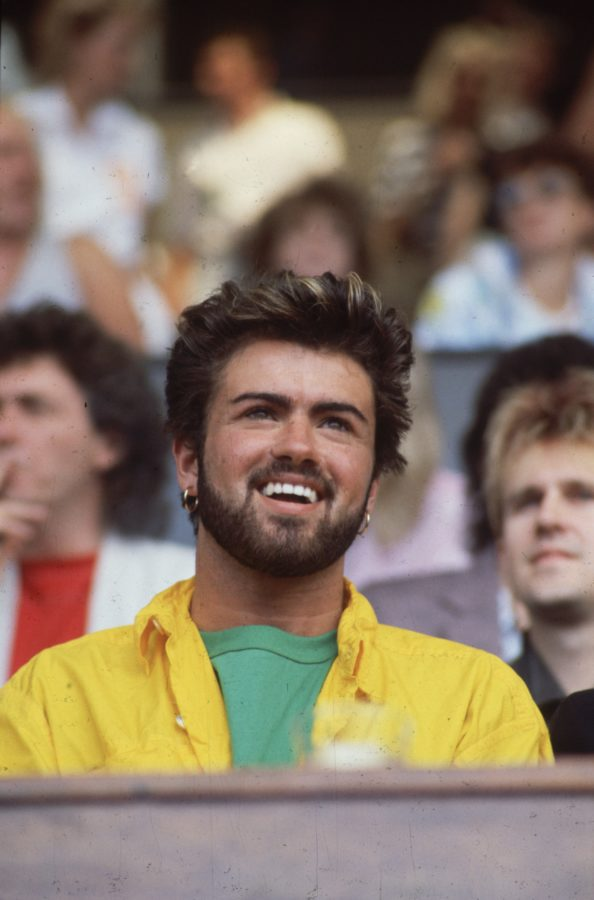 13th July 1985: British singer songwriter George Michael, lead singer of the pop group Wham!, at the Live Aid Concert in Wembley Stadium, London. (Photo by Hulton Archive/Getty Images)