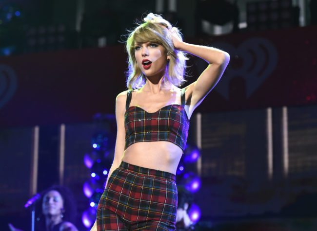 Taylor Swift performs onstage during iHeartRadio Jingle Ball 2014, hosted by Z100 New York and presented by Goldfish Puffs at Madison Square Garden on December 12, 2014 in New York City. (Photo by Jamie McCarthy/Getty Images for iHeartMedia)