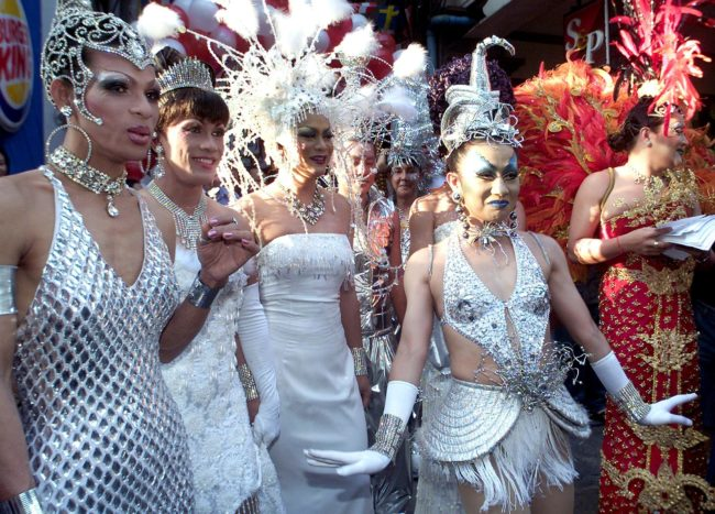 BANGKOK, THAILAND: Gays and Lesbians dressed in fancy costumes pose for a photo during the Bangkok Gay Festival 2000 in Bangkok, 05 November 2000. The Bangkok Gay Festival attracts Gays and Lesbians from around the world, joining in a colourful march to help stop AIDS. AFP PHOTO/Pornchai KITTIWONGSAKUL. (Photo credit should read PORNCHAI KITTIWONGSAKUL/AFP/Getty Images)