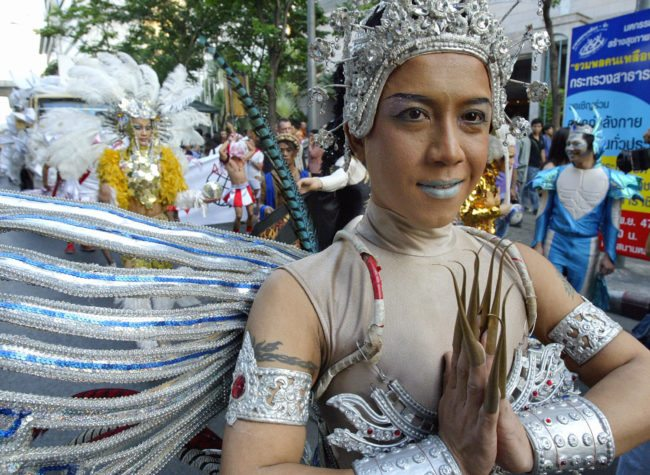 "BANGKOK, THAILAND: Thai gays march in an annual ""Gay Pride"" parade on Silom road downtown Bangkok, 21 November 2004. Thai transvestites and homosexuals joined the parade along with some western counterparts at the end of their week long celebrations. AFP PHOTO/ SAEED KHAN (Photo credit should read SAEED KHAN/AFP/Getty Images)"