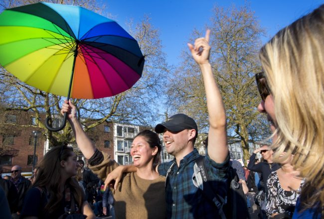 Participants are pictured during the 'Hand in Hand for Diversity' demonstration against anti-LGBT violence in Arnhem, The Netherlands, on April 8, 2017. The couple had been attacked on their way home early on April 2, 2017 in the eastern city of Arnhem. One of them lost several teeth and got a bloody lip after being attacked with a bolt-cutter. Dutch male politicians, police and diplomats have taken to streets around the world holding hands this week in a very public show of support after a brutal attack on the gay couple. / AFP PHOTO / ANP / Piroschka van de Wouw / Netherlands OUT (Photo credit should read PIROSCHKA VAN DE WOUW/AFP/Getty Images)