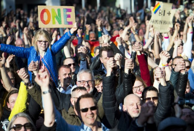 People hold hands during the Hand in Hand for Diversity, a demonstration against anti-LGBT violence triggered after a gay couple was beaten up, on April 8, 2017 in Arnhem. / AFP PHOTO / ANP / Piroschka van de Wouw / Netherlands OUT (Photo credit should read PIROSCHKA VAN DE WOUW/AFP/Getty Images)