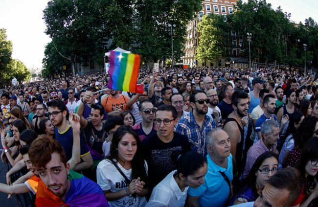 A reveller waves a Rainbow Flag as he and thousands attend the closing ceremony of the WorldPride Madrid 2017 in Madrid on July 2, 2017. Hundreds of thousands of revellers young and old danced, cheered and partied on the rainbow streets of Madrid on July 1, 2017 in the world's biggest march for gay, lesbian, bisexual and transgender rights. / AFP PHOTO / OSCAR DEL POZO (Photo credit should read OSCAR DEL POZO/AFP/Getty Images)