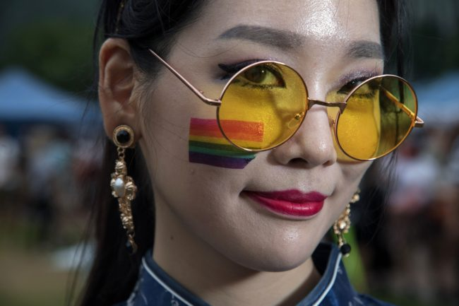 Participant Nae-Gyeol Song poses for a photo during a 'Gay Pride' gathering in Seoul on July 15, 2017. Thousands of people celebrated gay rights with song, dance and a march in Seoul on July 15, amid rain and boisterous protests by conservative Christians. Religious South Koreans have been a loud fixture at the annual parade for years, holding a rival anti-homosexuality rally while trying to physically block the march.     / AFP PHOTO / Ed JONES        (Photo credit should read ED JONES/AFP/Getty Images)