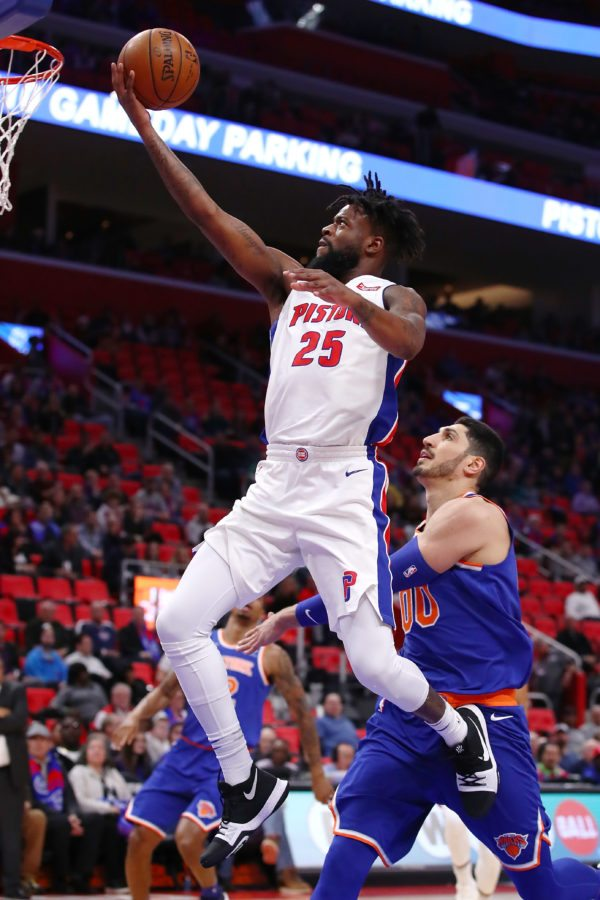 DETROIT, MI - DECEMBER 22:  Reggie Bullock #25 of the Detroit Pistons drives to the basket past Enes Kanter #00 of the New York Knicks during the first half at Little Caesars Arena on December 22, 2017 in Detroit, Michigan. NOTE TO USER: User expressly acknowledges and agrees that, by downloading and or using this photograph, User is consenting to the terms and conditions of the Getty Images License Agreement. (Photo by Gregory Shamus/Getty Images)