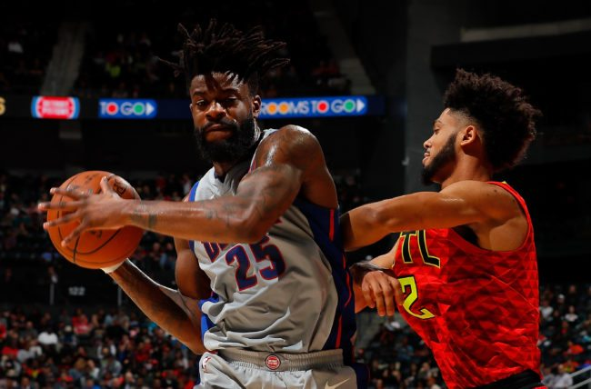 ATLANTA, GA - FEBRUARY 11:  Reggie Bullock #25 of the Detroit Pistons grabs a rebound against Tyler Dorsey #2 of the Atlanta Hawks at Philips Arena on February 11, 2018 in Atlanta, Georgia.  NOTE TO USER: User expressly acknowledges and agrees that, by downloading and or using this photograph, User is consenting to the terms and conditions of the Getty Images License Agreement.  (Photo by Kevin C. Cox/Getty Images)