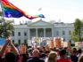 Demonstrators wave flags and banners in front of the White House in Washington (Maria Belen Perez Gabilondo/AFP/Getty Images)