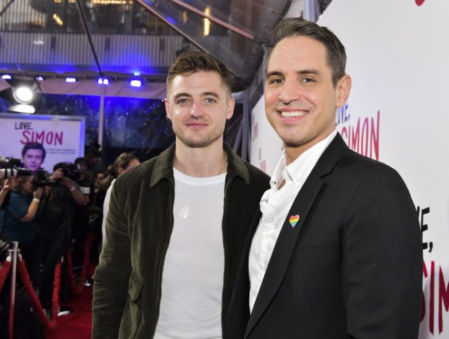 "LOS ANGELES, CA - MARCH 13: Director Greg Berlanti (R) and soccer player Robbie Rogers attend a special screening of 20th Century Fox's ""Love, Simon"" at Westfield Century City on March 13, 2018 in Los Angeles, California. (Photo by Rodin Eckenroth/Getty Images)"