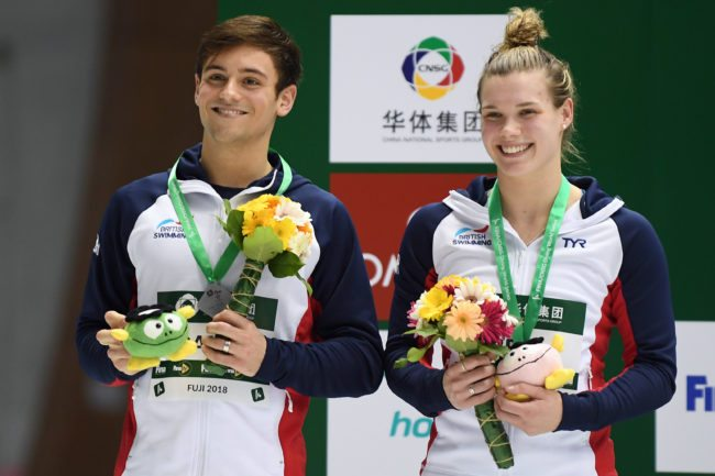 FUJI, JAPAN - MARCH 17: Grace Reid and Thomas Daley of Great Britain (silver) smile on the podium after the Mixed 3m Synchro Springboard final during day three of the FINA Diving World Series Fuji at Shizuoka Prefectural Fuji Swimming Pools on March 17, 2018 in Fuji, Shizuoka, Japan. (Photo by Atsushi Tomura/Getty Images)