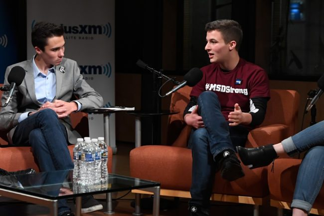 WASHINGTON, DC - MARCH 23: Dan Rather hosts a SiriusXM Roundtable Special Event with Parkland, Florida, Marjory Stoneman Douglas High School Students and activists Emma Gonzalez, David Hogg (L), Cameron Kasky (R), Alex Wind, and Jaclyn Corin at SiriusXM Studio on March 23, 2018 in Washington, DC. (Photo by Larry French/Getty Images for SiriusXM)