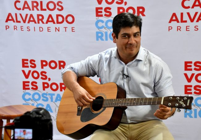 Costa Rican presidential candidate for the Citizen Action Party (PAC), Carlos Alvarado plays the guitar during a Facebook Live broadcast in San Jose, Costa Rica, on March 29, 2018.  Costa Rica faces a presidential runoff between Fabricio Alvarado, a 43-year-old lawmaker, pastor and singer with the National Restoration Party, and Carlos Alvarado, a former minister from the leftist ruling party. Despite the shared last name, the two men are unrelated. / AFP PHOTO / Ezequiel BECERRA        (Photo credit should read EZEQUIEL BECERRA/AFP/Getty Images)