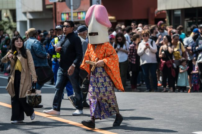KAWASAKI, JAPAN - APRIL 01: (EDITORS NOTE: Image contains suggestive content.) A man wear a phallic-shaped hat during Kanamara Matsuri (Festival of the Steel Phallus) on April 1, 2018 in Kawasaki, Japan. The Kanamara Festival is held annually on the first Sunday of April. The penis is the central theme of the festival, focused at the local penis-venerating shrine which was once frequented by prostitutes who came to pray for business prosperity and protection against sexually transmitted diseases. Today the festival has become a popular tourist attraction and is used to raise money for HIV awareness and research. (Photo by Carl Court/Getty Images)