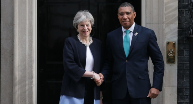 Britain's Prime Minister Theresa May (L) greets Jamaica's Prime Minister Andrew Holness on arrival at 10 Downing street (Getty)