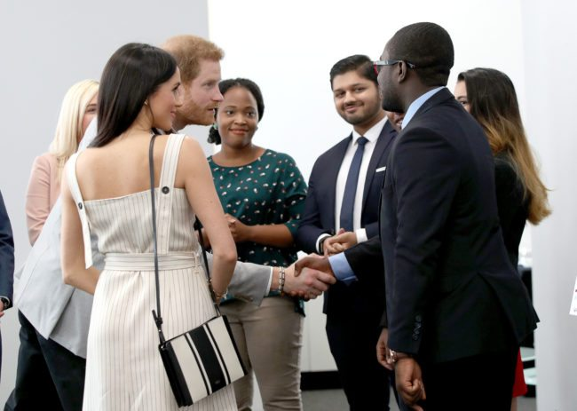 LONDON, UNITED KINGDOM - APRIL 18: Prince Harry and Meghan Markle speak with delegates from the Commonwealth Youth Forum at the Queen Elizabeth II Conference Centre, during the Commonwealth Heads of Government Meeting on April 18, 2018 in London, United Kingdom (Photo by Yui Mok - WPA Pool/Getty Images)
