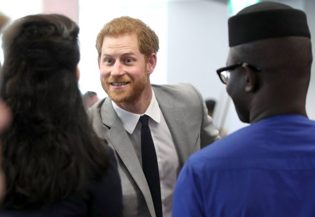 Britain's Prince Harry's attends a reception with delegates from the Commonwealth Youth Forum in central London on April 18, 2018, on the sidelines of the Commonwealth Heads of Government meeting (CHOGM). / AFP PHOTO / POOL / Yui Mok (Photo credit should read YUI MOK/AFP/Getty Images)