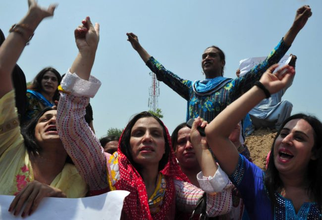 Pakistani eunuchs and transgenders demonstrate for their rights in the city of Peshawar on July 11, 2011. Pakistan's eunuchs are traditionally paid to help celebrate the birth of a son, or to dance at weddings or living on the streets begging or prostituting themselves. But in Muslim Pakistan, where sexual relations outside marriage are taboo and homosexuality is illegal, eunuchs are also treated as sex objects and often become the victims of violent assault. AFP PHOTO/A. MAJEED (Photo credit should read A.MAJEED/AFP/Getty Images)