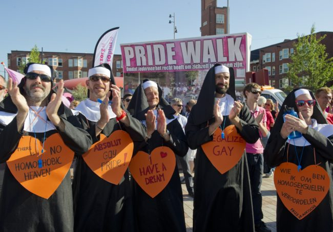 Homosexual and lesbian community members dressed as nuns participate in a Rainbow Pride Walk in Amsterdam, the Netherlands, on August 1, 2013. Hundreds of LGBT activists particpated in the rally to demand equal social and human rights for their community. The parade is part of Gay Pride Week. AFP PHOTO / ANP / MARCEL ANTONISSE   ***Netherlands out***        (Photo credit should read MARCEL ANTONISSE/AFP/Getty Images)