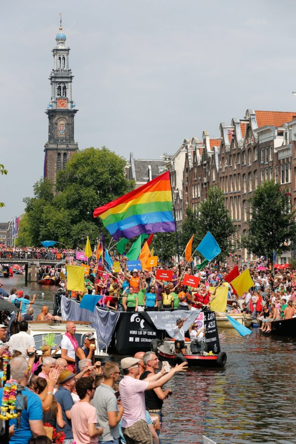 Members of the COC (Dutch organization for LGBT's) attend the annual canal parade in Amsterdam, on August 2, 2014. The parade is part of the Gay Pride Week. AFP PHOTO/ANP BAS CZERWINSKI netherlands out        (Photo credit should read BAS CZERWINSKI/AFP/Getty Images)