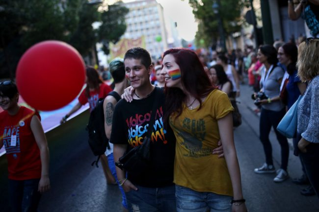 Two women take part in the annual Gay Pride parade in Athens, on June 13, 2015.  Greece's radical-left government on June 10, 2015, proposed a bill to grant same-sex couples the right to a civil union, two years after the European Court of Human Rights condemned the country's existing legislation as discriminatory. AFP PHOTO / ANGELOS TZORTZINIS        (Photo credit should read ANGELOS TZORTZINIS/AFP/Getty Images)