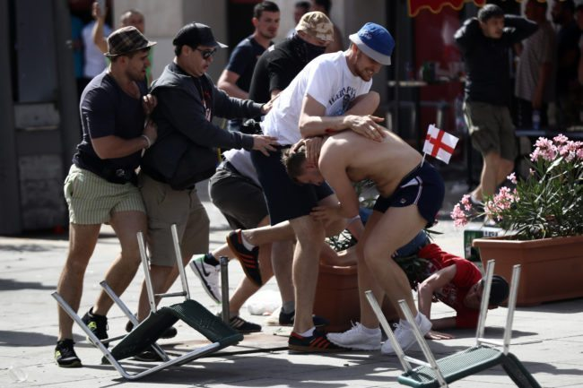 MARSEILLE, FRANCE - JUNE 11: England fans clash with Russian fans ahead of the game against Russia later today on June 11, 2016 in Marseille, France. Football fans from around Europe have descended on France for the UEFA Euro 2016 football tournament. (Photo by Carl Court/Getty Images)