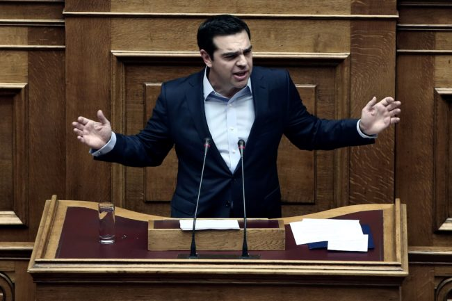 Greek Prime Minister Alexis Tsipras delivers a speech during a parliamentary session in Athens on December 10, 2016.  / AFP / Angelos Tzortzinis        (Photo credit should read ANGELOS TZORTZINIS/AFP/Getty Images)