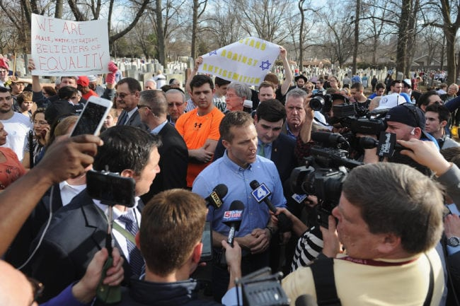 UNIVERSITY CITY, MO - FEBRUARY 22: Missouri Governor Eric Greitens speaks to the media at Chesed Shel Emeth Cemetery on February 22, 2017 in University City, Missouri. Governor Eric Greitens and U.S. Vice President Mike Pence were on hand to speak to over 300 volunteers who helped cleanup after the recent vandalism. Since the beginning of the year, there has been a nationwide spike in incidents including bomb threats at Jewish community centers and reports of anti-semitic graffiti. (Photo by Michael Thomas/Getty Images)