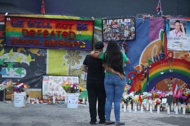 ORLANDO, FL - JUNE 12: Melinda Vargas and Natascha Soto (L-R) visit the memorial setup outside the Pulse gay nightclub as they remember those lost one year ago during a mass shooting on June 12, 2017 in Orlando, Florida. Omar Mateen killed 49 people at the club a little after 2 a.m. on June 12, 2016. (Photo by Joe Raedle/Getty Images)