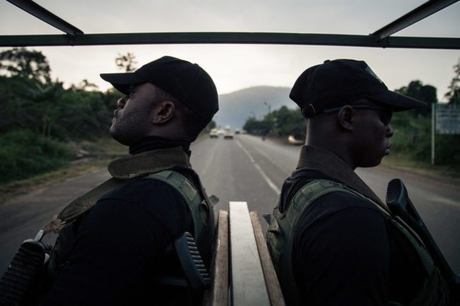 Soldiers of the 21st Motorized Infantry Brigade patrol in the streets of Buea, South-West Region of Cameroon on April 26, 2018. - A social crisis that began in November 2016 has turned into armed conflict since October 2017. Several small armed groups demand the independence of the two English-speaking regions of Cameroon, bordering Nigeria. (Photo by ALEXIS HUGUET / AFP) (Photo credit should read ALEXIS HUGUET/AFP/Getty Images)