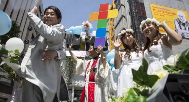 Two couples in wedding attire take part in the Tokyo Rainbow Pride Parade on May 6, 2018 in Tokyo, Japan.  (Tomohiro Ohsumi/Getty Images)
