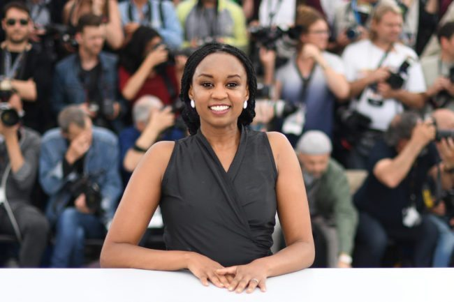 "Kenyan director Wanuri Kahiu poses on May 9, 2018 during a photocall for the film ""Rafiki"" at the 71st edition of the Cannes Film Festival in Cannes, southern France. (Photo by LOIC VENANCE / AFP/ Getty)"